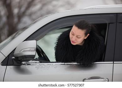 a pretty girl driving a car