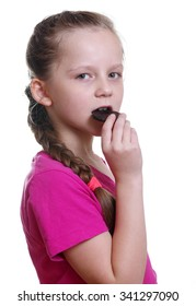 pretty girl eating chocolate bisquit