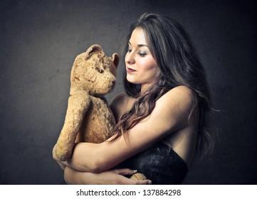 pretty girl embraces teddy bear