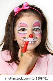 Pretty girl with face painting of a bunny.