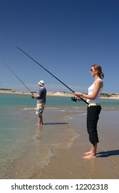 Pretty girl fishing at the beach