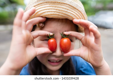 Pretty girl with fresh tomatoes