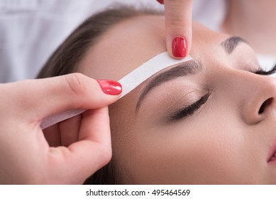 Pretty girl getting brow depilation