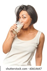 Pretty girl with a glass of milk