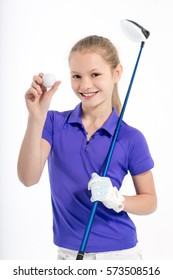 Pretty girl golfer posing with golf club on white backgroud in studio