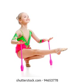 pretty girl gymnast doing exercises over white