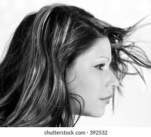 pretty girl hair blowing around her face