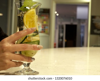 pretty girl hands with a coktail glass