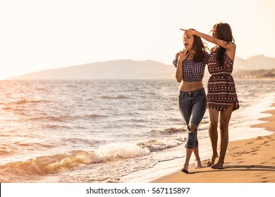 Pretty girl has a fun with her girlfriend on the beach