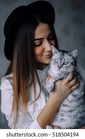 pretty girl in hat with cat