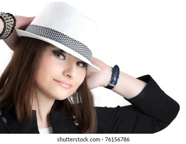 Pretty girl in the hat isolated on white.