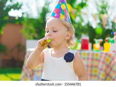 Pretty girl having fun at child's birthday party