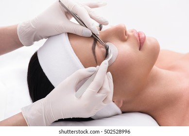 Pretty girl having her lashes lengthened