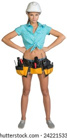 Pretty girl in helmet, shorts, shirt and tool belt with tools standing with hands on hip. Full length. Isolated over white background