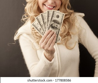 Pretty girl holding 500 dollars and smiling
