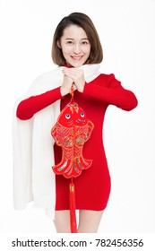 pretty girl holding chinese new year decoration,studio shot.