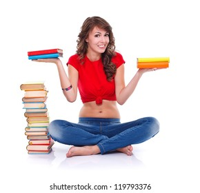 Pretty girl holding colorful books in both hands over white background