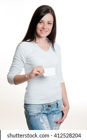 Pretty girl holding empty white visiting card