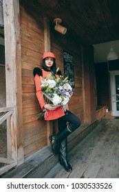 pretty girl holding a large bouquet of flowers