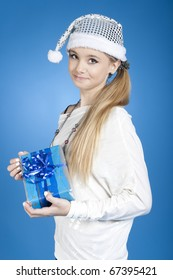 Pretty girl holding presents