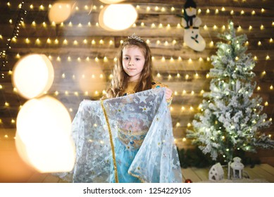 pretty girl holding skirt of oriental dress for christmas party