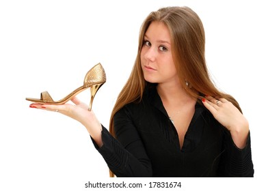 Pretty girl holding a stiletto in hand