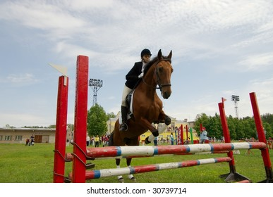 pretty girl horse jump equestrian and audience