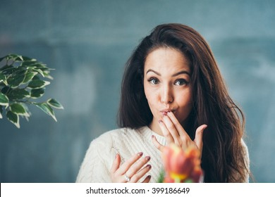 A pretty girl is licking her fingers and show us that she ate something tasty