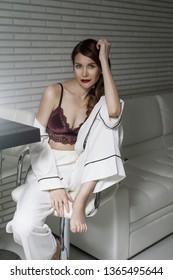 Pretty girl in lingerie at design interior