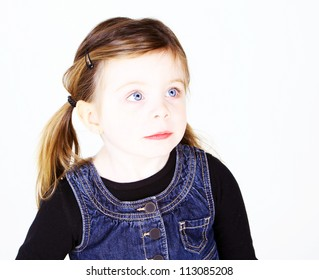 Pretty girl looking off to side in studio