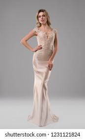 Pretty girl in luxurious evening dress shot