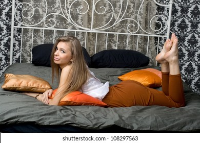 Pretty girl lying on bed