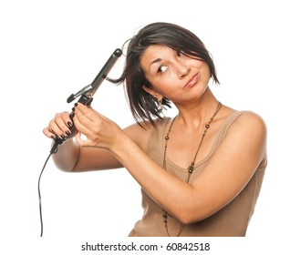 Pretty girl makes styling with hair tongs