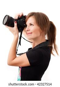 Pretty girl making photo using professional camera. Over white