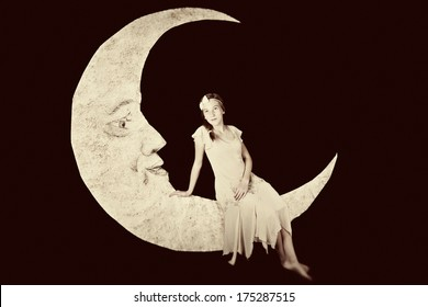 Pretty girl on vintage paper moon