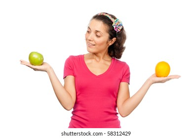 Pretty girl with orange and green apple