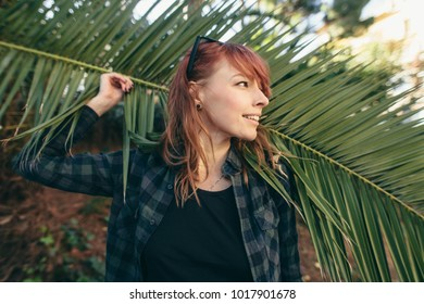 pretty girl and palm leaves Barcelona Spain