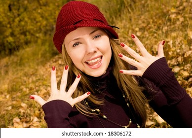 pretty girl in the park showing her beautiful nails