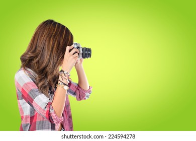 Pretty girl photographing over green background