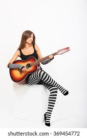 Pretty girl playing the acoustic guitar