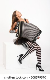 Pretty girl playing the Russian bayan (button accordion) and singing
