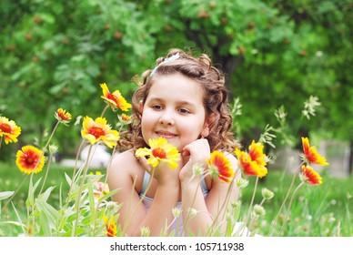 Pretty girl portrait among the yellow flowers