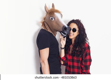 Pretty girl portrait and her horse head boyfriend