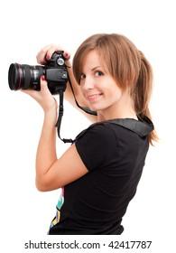 Pretty girl with professional photo camera. Over white