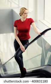 pretty girl in red blouse in the the airport