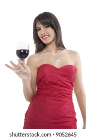 Pretty girl in red dress drinking wine