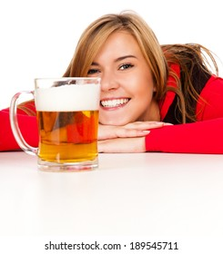 pretty girl in red drinking beer from the mug, white background