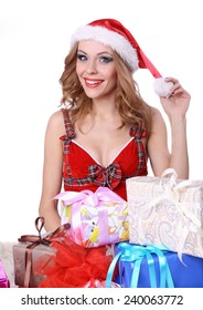 Pretty girl in a red hat with colorful bags isolated over white background.