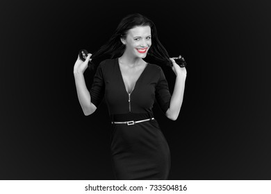 Pretty girl with red lips holding her hair black and white