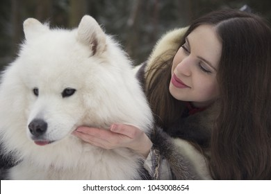 pretty girl with samoyed in the forest